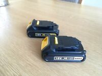Two DEWALT 18Volt XR LI-ION 1.5A batteries.