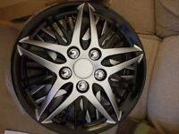 """New 14"""" black and silver wheel trims"""