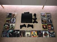 PS3 Slim 250GB, 22 great games, 2 controllers & charging stand