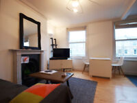 A modern & bright 2 bedroom 1st floor flat with a private terrace on tree-lined street in Finsbury P