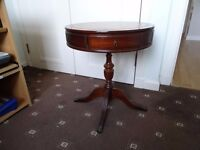 Mahogany reproduction side table with gold coloured embossing on brown leather inset.