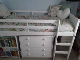 White wooden mid sleeper bed with storage