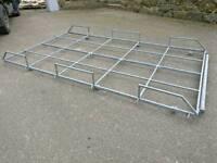 Van roof rack with roller