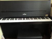 Upright black Piano