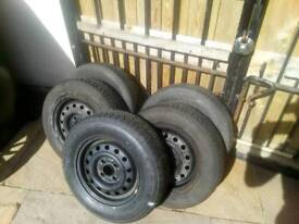 5 steel wheels with tyres