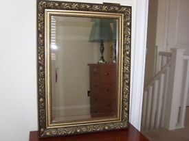 Carved design gold mirror.