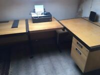 Three office desks, two with drawers. Can be sold separately.
