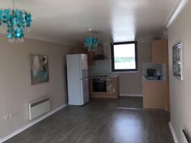 2 BED MODERN SECOND FLOOR FLAT WITH PARKING