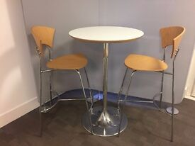 2 bar chairs and round table with chrome base