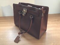 Genuine Michael Kors bag, never been used and excellent condition . Tan coloured with gold