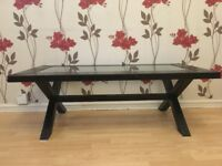 Glass coffee table with black frame