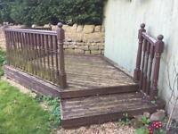 Garden decking area with balustrade