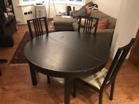 IKEA Black dining table and three chairs
