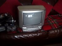Aiwa small old style television with built in VHS player..plus ten vhs tapes...( choice of 200)..