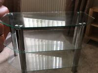 3 Tier Clear Glass TV stand. £30 Ono - local pick-up only.