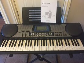Casio CTK-651 keyboard with music stand and keyboard stand