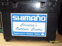 Shimano Tackle Box/Seat with shoulder strap. Has 2 trays inside at the top. Good condition.