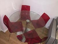 Round glass table with 4 transparent chairs BRANDNEW!