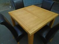 OAK TABLE AND 4 CHAIRS at Haven Trust's charity shop at 247 Radford Road, NG7 5GU