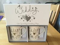two wedding mugs in the original box never used