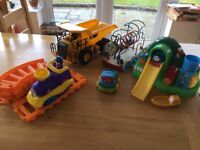 Bundle of toddler toys including CAT dumper truck, train and track, Thomas the Tank Engine toys