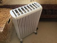 2oil filled electric space heaters. Very economical to run. As new.