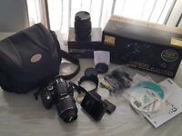 Nikond D5100 digital camera with lens and bag