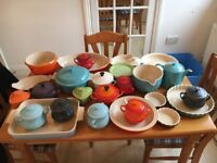 Large selection of le cruset dishes, plates and pots