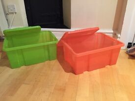 Two plastic storage/toy boxes with Lids.