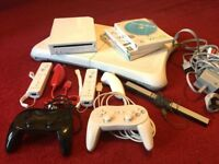Nintento Wii console with Wii Fit board + Games