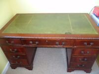 Antique Style leather top desk.Mahogany Repro. 9 Drawers.