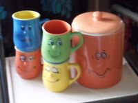 fairtrade biscuit barrel and four cups. bright, fun !