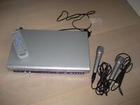 Roadstar Karaoke/DVD Player and 2 microphones