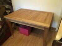 Extending Oak Table. Quality workmanship and solid wood.