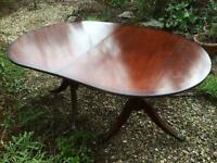 Regency style mahogany dining table with claw feet