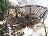 wooden garden bench with curved back in need of reconstruction