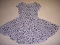 Girls Dress leopard print. Age 7-8 yrs. Height 128cm chest 54 cm.