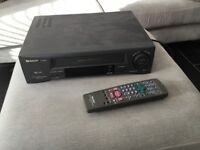 Sharp VHS video with remote & instructions