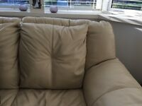 Two seater leather sofas x2 cream