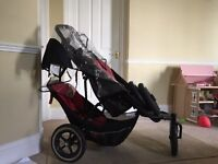 Mama and Papa's double buggy for sale with spare wheels and water proof cover