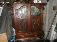 Beautiful Antique display cabinet very unusual piece with lovely carvings