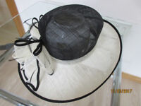 Ladies hat, black crown and cream brim