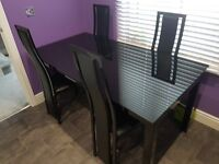 Noir Extending Dining Table & 6 Upholstered Chairs.