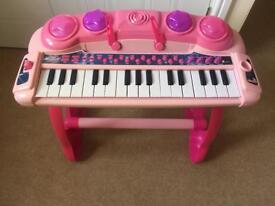 Pink musical toy piano