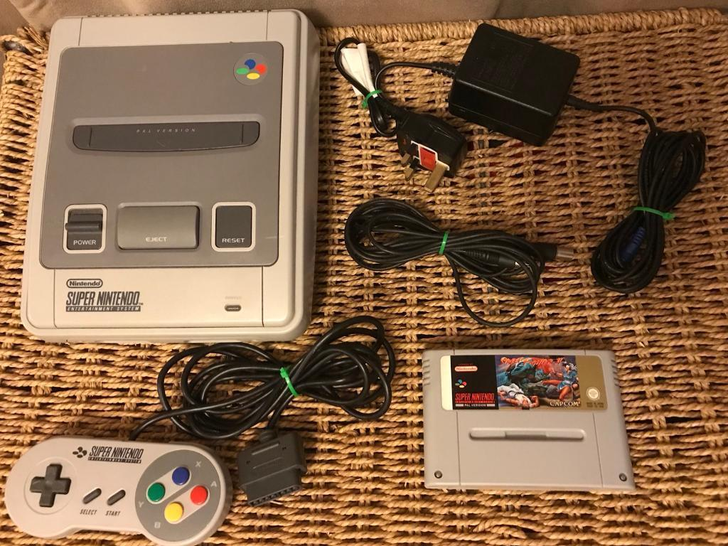 Nintendo SNES console with street fighter 2 game.