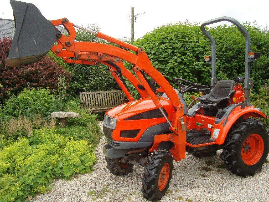 Kioti Compact Tractors : Kioti compact tractor and loader with bucket fork in