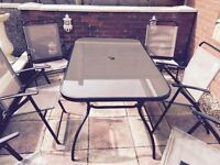 Glass Patio table and 6 chair and parasol