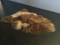 Bleached sheepskin rug, lovely markings, very shaggy long pile
