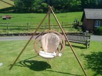 CIRCA SWINGING SEAT with cushion and tripod stand. The ultimate luxury in garden furniture.