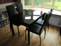Black Glass Extending Dining Table with 4 Upholstered Chairs